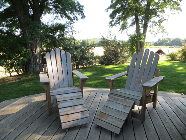 photo: Farm Stay at the Gite — Two chairs on the deck | Monteillet Fromagerie