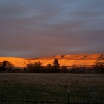 Photo of Sunset on the Distant Hills at Monteillet Fromagerie