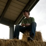 Boy on Hay Bales - Farm Stay Photo by Steve Scardina.