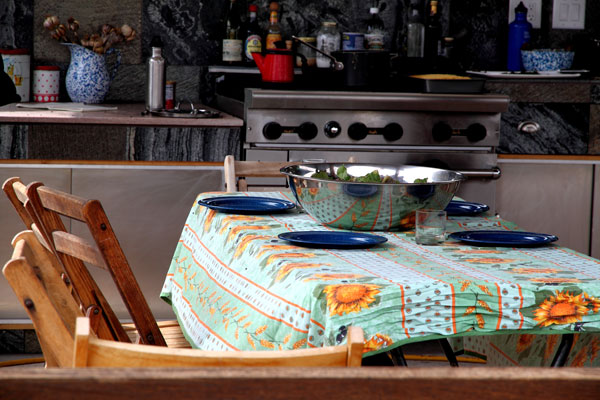 Photo of Outdoor Kitchen with Table Set for Dinner - Photo by Cameron Riley (Pastry Ninja Photography)