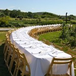 photo of long table set for dinner—2011 Outstanding in the Field Dinner—photo by The Farm Chicks