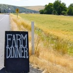 photo of Farm Dinner sign—2011 Outstanding in the Field Dinner—photo by The Farm Chicks