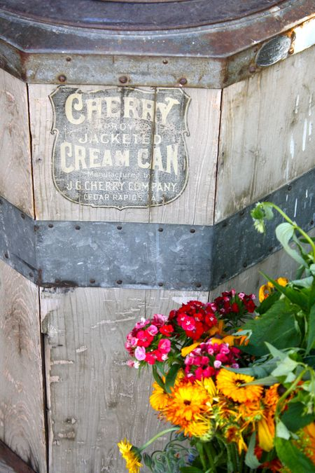 photo of antique cream can and flowers—2011 Outstanding in the Field Dinner—photo by The Farm Chicks