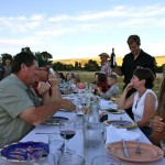 photo of people enjoying their meal—2011 Outstanding in the Field Dinner—photo by The Farm Chicks